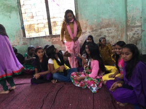"""This group of adolescent girls, most in school but some """"left-outs"""" or """"drop-outs"""" are learning hygiene and nutrition peer-to-peer."""