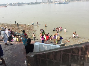 Ceremonial bathing and placing Saraswathi clay figures into the Ganges