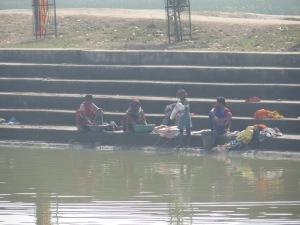 Women washing at the manmade lake.