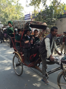 Girls going to school via bicycle rickshaw.