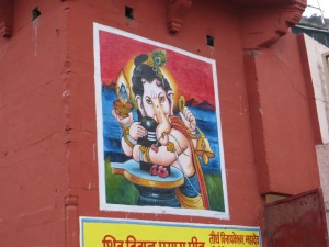 This is an enormous wall painting of Ganesh, looming over the ghat (steps to the river).