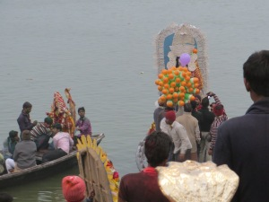 Unlike Rajghat in Kolkata, here the clay statues are taken out by boat, to much cheering and banging, and then dumped overboard.