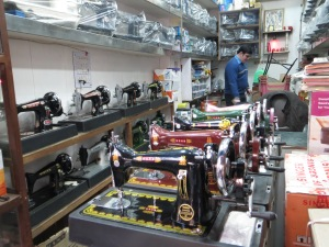 Shiny new manual sewing machines--the ones we saw at street tailors and in, for example, the place in Jaipur where I bought the Afghan antique fabric.