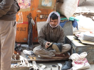 Shoe repairman on the sidewalk (common).
