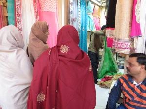 Families buying saris.