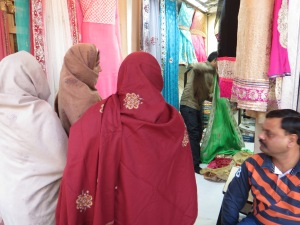 Families buying saris.