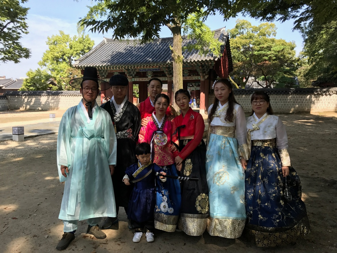 Beautiful hanbok-clad family at the palace
